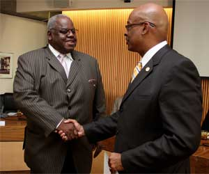 Harold Williams, left, is congratulated by PCC District President Preston Pulliams after Williams won the Pacific Region Trustee Leadership Award in 2010.